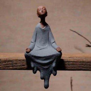 Ceramic meditating buddha